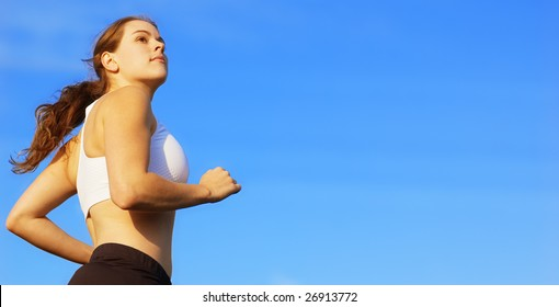 Beautiful young woman runner having a workout session.
