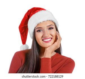 Beautiful young woman in Santa Claus hat on white background