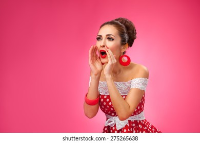Beautiful young woman says. All over pink background