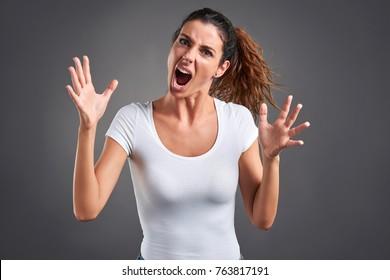 A beautiful young woman screaming furiously.