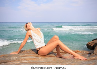 Beautiful young woman in the sea
