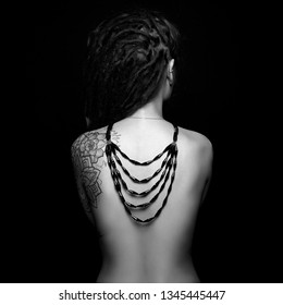 beautiful young woman sexy back. luxury. beauty naked Girl with tattoo and necklace on her back