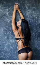 Beautiful young woman in a sexy black lingerie