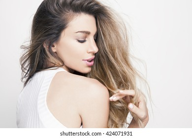 beautiful young woman with shiny hair and bright makeup. Lifestyle and cosmetics concept. studio shot, horizontal.