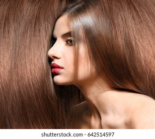Beautiful young woman with shiny long hair. Beauty concept
