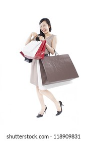 beautiful young woman with shopping bags isolated on white background