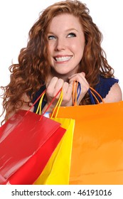 Beautiful young Woman with shopping bags isolated over white background
