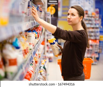 Beautiful young woman shopping for cereal, bulk in a grocery supermarket