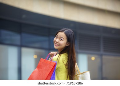 a beautiful young woman shopping happily