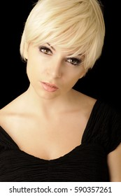 Beautiful young woman with short blond hair