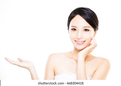 Beautiful young woman showing empty copy space on the open hand palm
