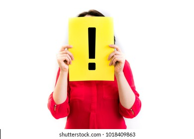 beautiful, young woman showing a exclamation mark on a yellow piece of paper in front of her head, on a white background. Anonymous business. Pretty slim girl studio photo