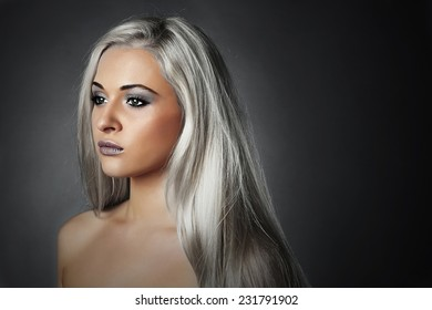 beautiful young woman with silver hair.Sad girl.healthy hair.Beauty salon