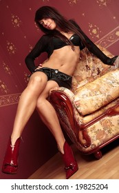 Beautiful young woman sitting in chair.