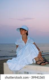 beautiful young woman sitting on beach