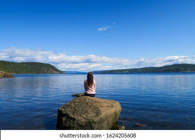 beautiful-young-woman-sitting-peace-260n