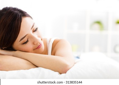 beautiful young  woman  sleep on the bed