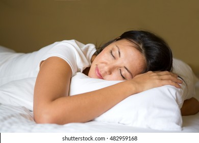 Beautiful young woman sleep on the bed.