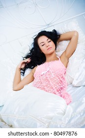Beautiful young woman sleep in white bed
