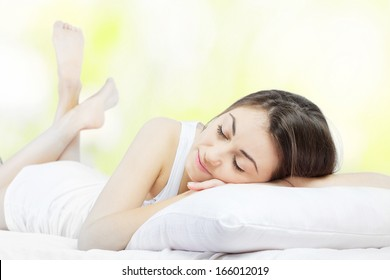 Beautiful young woman sleeping in the bed.