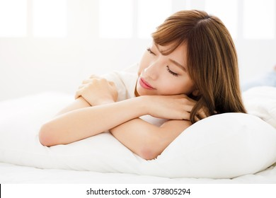 Beautiful young woman sleeping in bedroom