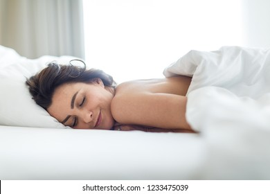 Beautiful young woman sleeping on bed at bedroom