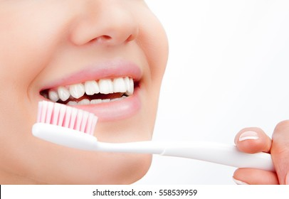 Beautiful young woman smile with brushing teeth . Dental health background.