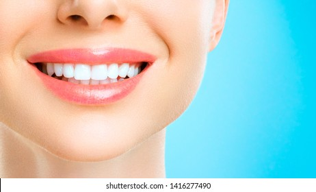 Beautiful young woman smile. Dental health background