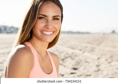 beautiful young woman smiling at the beach in California.