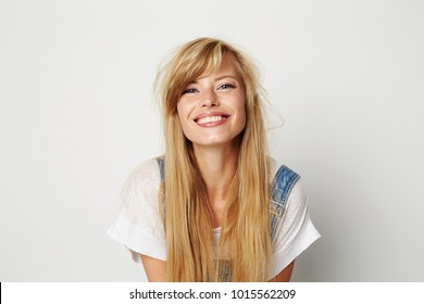 beautiful young woman smiling to camera in white studio