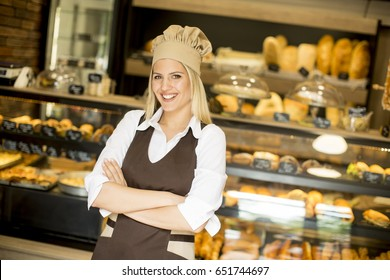 Beautiful young woman smiling confidently posing in her baker shop