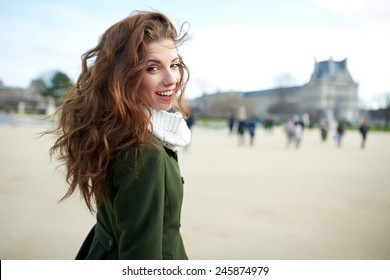 Beautiful young woman smiling. Walking in the city