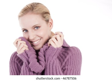 Beautiful young woman in soft sweater, isolated on white
