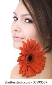 Beautiful young woman in spa with flower. Isolated.