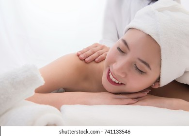 Beautiful young woman in spa massage.