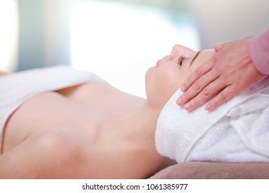 Beautiful young woman spa on face relaxing receiving massage,Spa concept