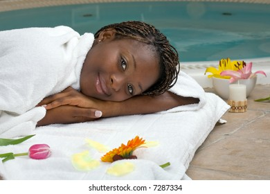 beautiful young woman in the spa room dressing an white bathrobe