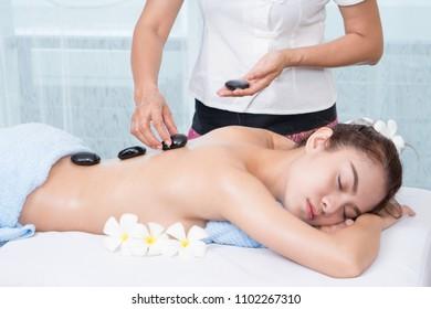 Beautiful young woman in spa salon.