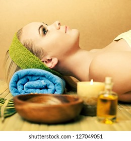 Beautiful young woman at a spa salon. Perfect Skin. Skincare. Young Skin