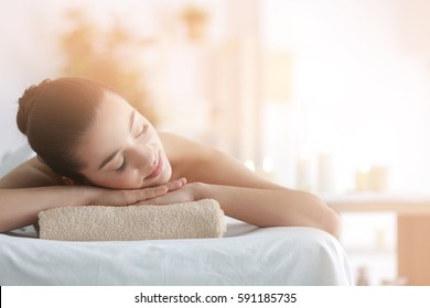 Photo of Beautiful young woman in spa salon