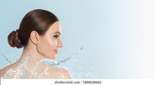 Beautiful young woman and splashing water on light background, space for text. Spa portrait