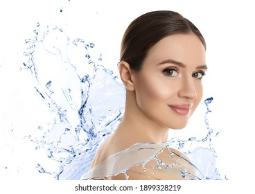 Beautiful young woman and splashing water on white background. Spa portrait