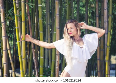 beautiful young woman in spring bamboo grove look at the sight