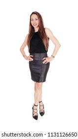 A beautiful young woman standing from the front in a black blouse and 