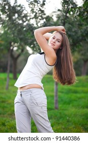 beautiful young woman standing on green grass