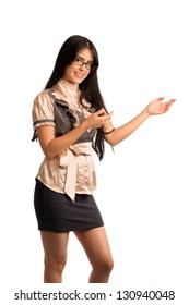 Beautiful young woman standing and pointing her hands to a side showing something