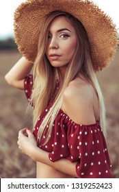 Beautiful and young woman straw hat summer in field. Concept village girl nature. Emotions tenderness, elegance, sensual look and romantic atmosphere. Outdoor activities beautiful natural woman.