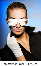 Beautiful young woman with stylish shutter shades sunglasses