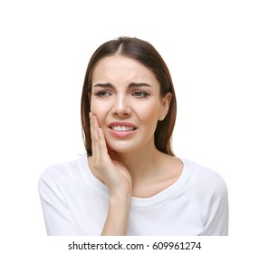 Beautiful young woman suffering from toothache on white background