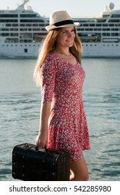 Beautiful young woman with suitcase. Travel concept.